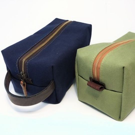 Toiletry Bag - canvas and leather with a 600D waterproof lining.