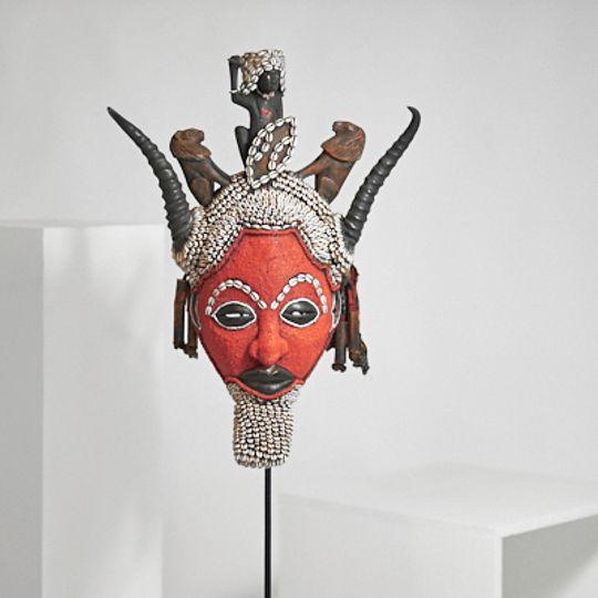 Dark orange mask from the Congo