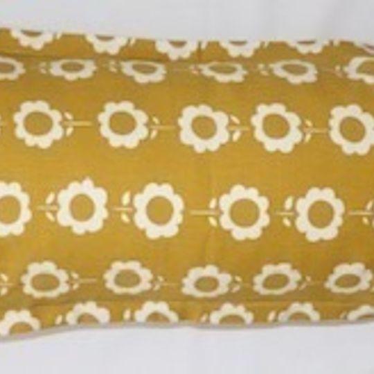 Daisychain mustard cushion cover