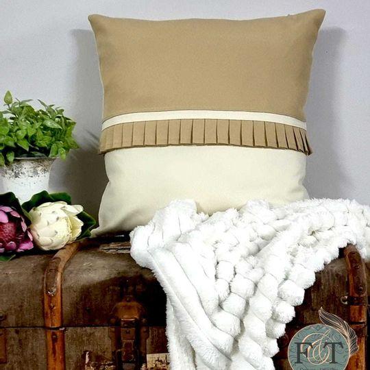 Cushion with pleats