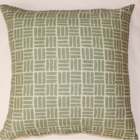 Sage green weave print cushion cover on linen background